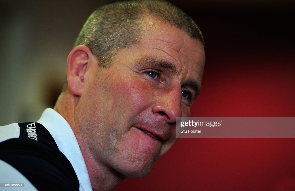 England head coach <a gi-track='captionPersonalityLinkClicked' href=/galleries/search?phrase=Stuart+Lancaster&family=editorial&specificpeople=2263180 ng-click='$event.stopPropagation()'>Stuart Lancaster</a> faces the press during the England Rugby Union Senior and Saxons Elite Player Squads Announcement at West Park RUFC on January 9, 2013 in Leeds, England.