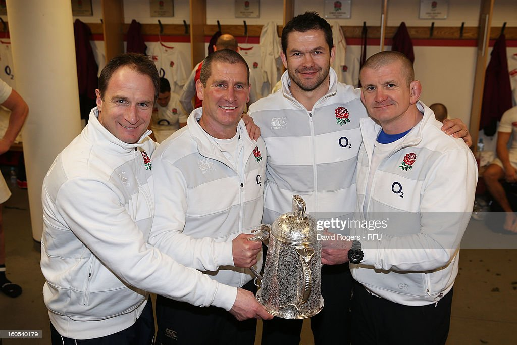 England head coach Stuart Lancaster holds the Calcutta Cup with fellow coaches Mike Catt Andy Farrell and Graham Rowntree during the RBS Six Nations...