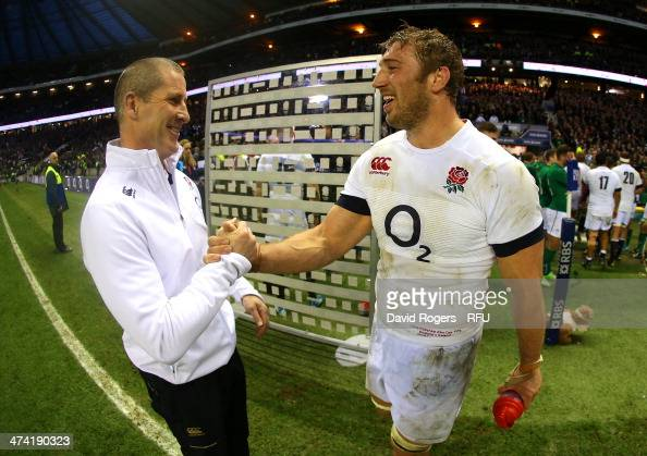 England head coach Stuart Lancaster shakes hand with Captain Chris Robshaw of England after victory during the RBS Six Nations match between England...