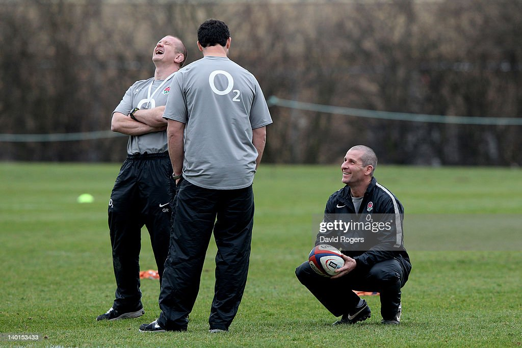 England head coach Stuart Lancaster shares a joke with his assistant coaches Graham Rowntree and Andy Farrell during the England training session at...