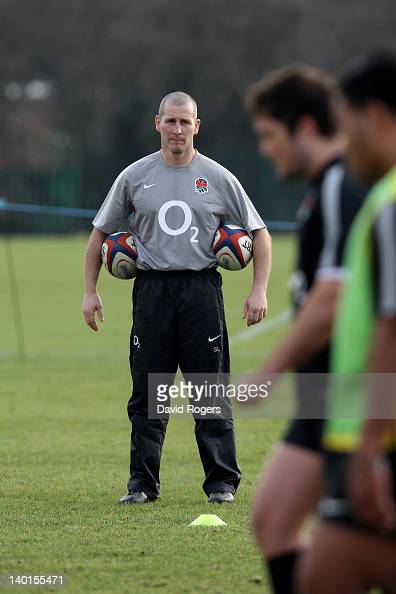 England head coach Stuart Lancaster watches over his players during the England training session at Loughborough University on February 29 2012 in...