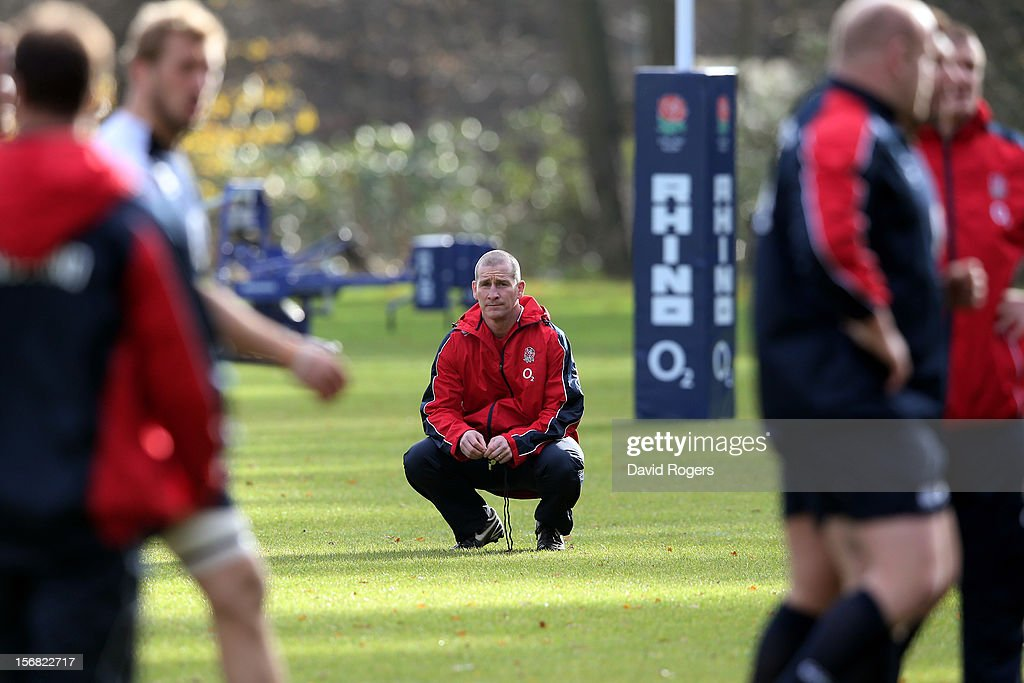 England head coach Stuart Lancaster watches over his players during the England training session at Pennyhill Park on November 22, 2012 in Bagshot, England.