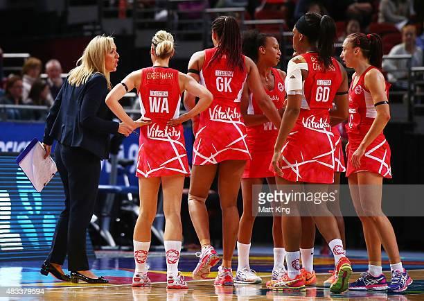 England head coach Tracey Neville speaks to her players during the 2015 Netball World Cup match between England and Jamaica at Allphones Arena on...