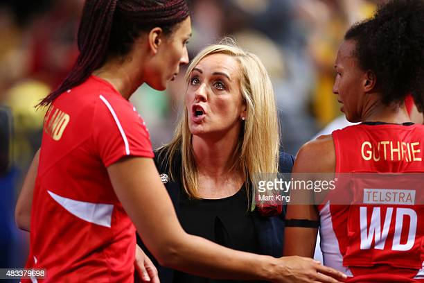 England head coach Tracey Neville talks to Geva Mentor of England after victory in the 2015 Netball World Cup match between England and Jamaica at...