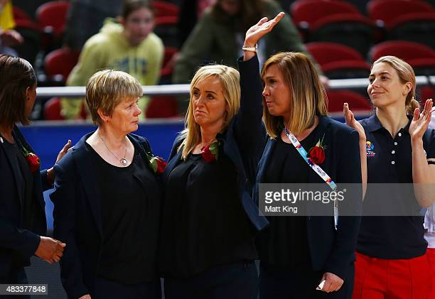 England head coach Tracey Neville waves towards family members after a moment silence was observed following the death of her father Neville Neville...