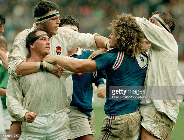 England hooker Brian Moore is held back by Martin Bayfield as he confronts JeanFrancois Tordo of France during the Rugby Union International between...