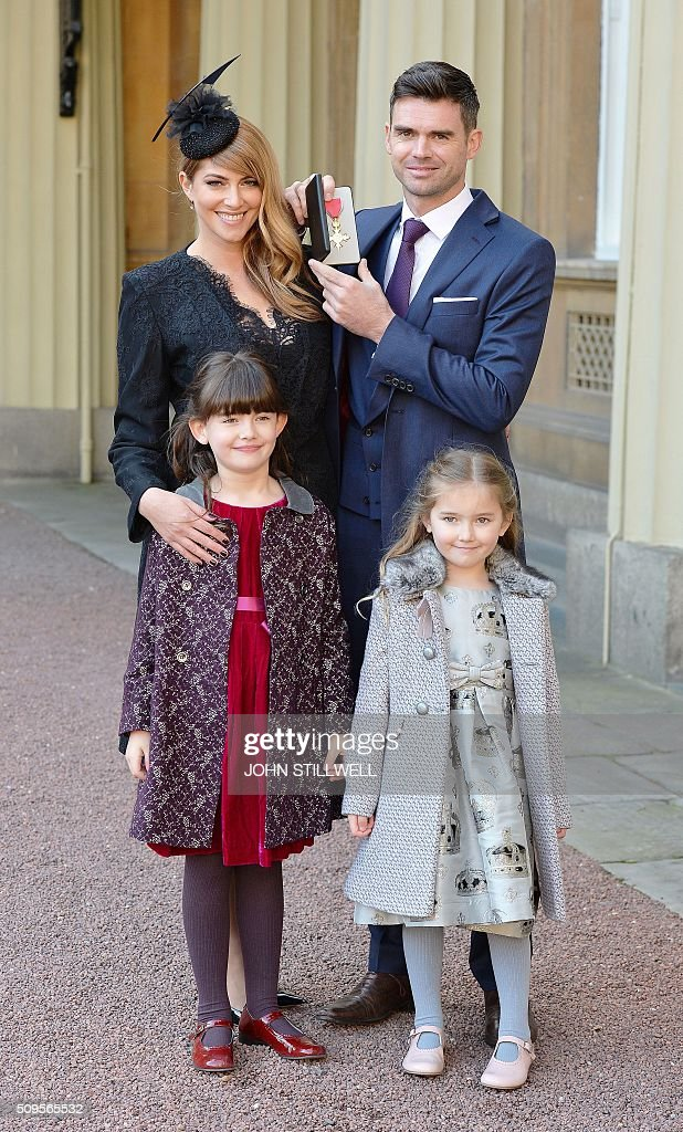 England international cricket player James Anderson (back R) poses with his medal with wife Daniella (back L) and daughters Lola (front L) and Ruby (front R) after being appointed an Officer of the Order of the British Empire (OBE) for services to cricket at an investiture ceremony at Buckingham Palace in London on February 11, 2016. / AFP / POOL / John Stillwell