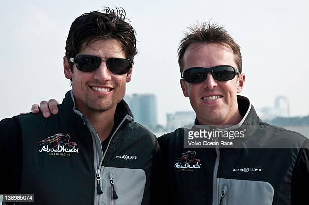 England international cricketers Alastair Cook and Graeme Swann after jumping from Abu Dhabi Ocean Racing skippered by Ian Walker from the UK during...
