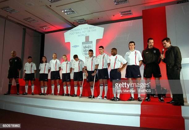 England international players at various levels pose in the new home kit as Sky Sports presenter Richard Keys talks to England goalkeeper David Seaman