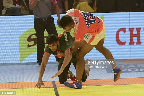 England kabaddi player Joshua Cherian Enson prevents a Bangladeshi opponent from crossing over during a match between England and Bangladesh at the...