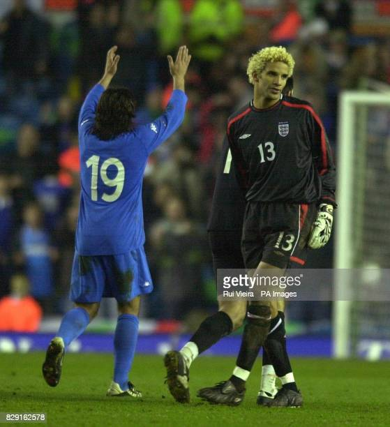 England keeper David James looks dejected as Italy's Rino Gattuso celebrates his sides 21 victory during the International friendly match at Elland...