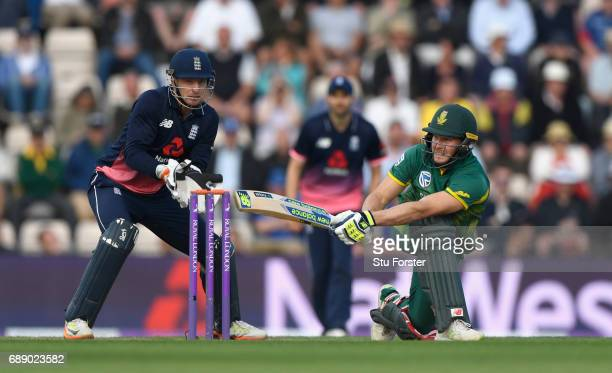 England keeper Jos Buttler looks on as South Africa batsman David Miller hits a boundary during the 2nd Royal London One Day International between...
