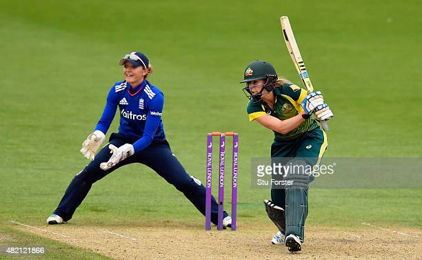 England keeper Sarah Taylor looks on as Australia batsman Ellyse Perry hits out during the 3rd Royal London ODI of the Women's Ashes Series between...