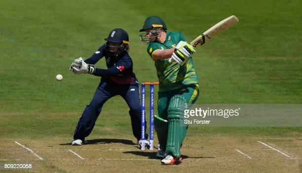 England keeper Sarah Taylor looks on as Lizelle Lee hits out during the ICC Women's World Cup 2017 match between England and South Africa at The...