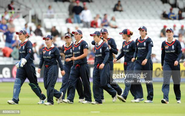 England leave the field after bowling out New Zealand for 85 runs during the Final of the Women's ICC World Twenty20 at Lords London