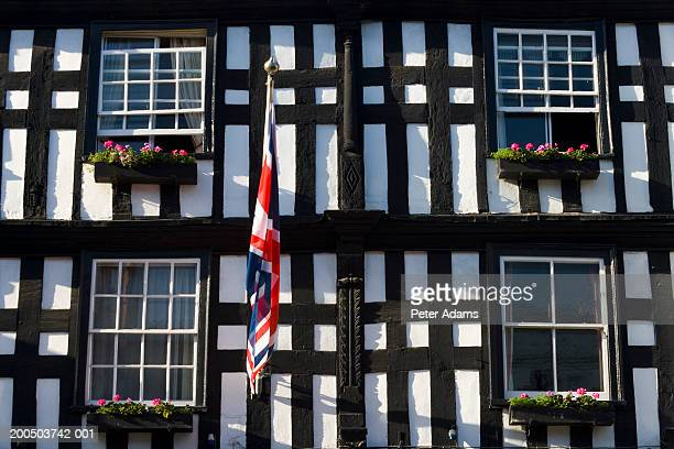 UK, England, Ledbury, tudor timber-framed facade and Union Jack flag