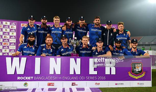 England lift the series trophy after winning the 3rd One Day International match between Bangladesh and England at Zohur Ahmed Chowdhury Stadium on...