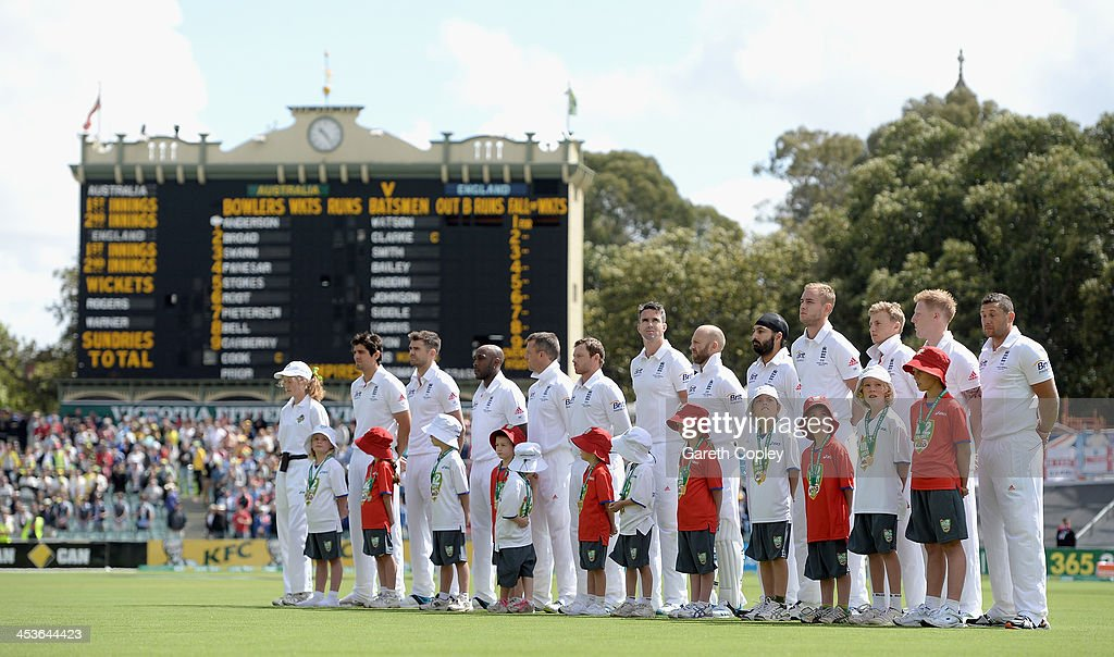England line up for the national anthems ahead of day one of the Second Ashes Test Match between Australia and England at Adelaide Oval on December 5, 2013 in Adelaide, Australia.