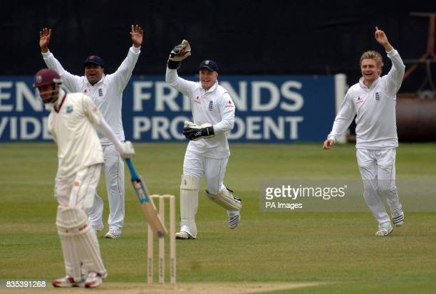 England Lions' Samit Patel wicket keeper Tim Ambrose and Luke Wright celebrate the fall of the wicket of West Indies' Lendl Simmons off the bowling...