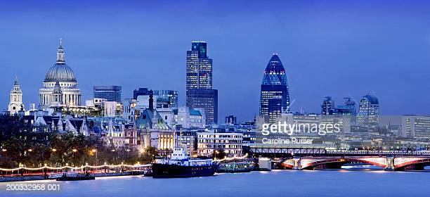 England, London cityscape, river Thames in foreground, dusk