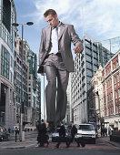 England, London, Financial District, giant businessman walking street