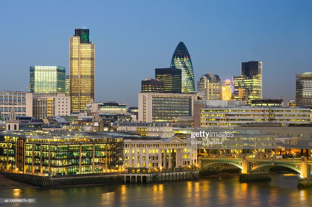 England, London, financial office buildings including 'the Gherkin' and Tower 42 at dusk