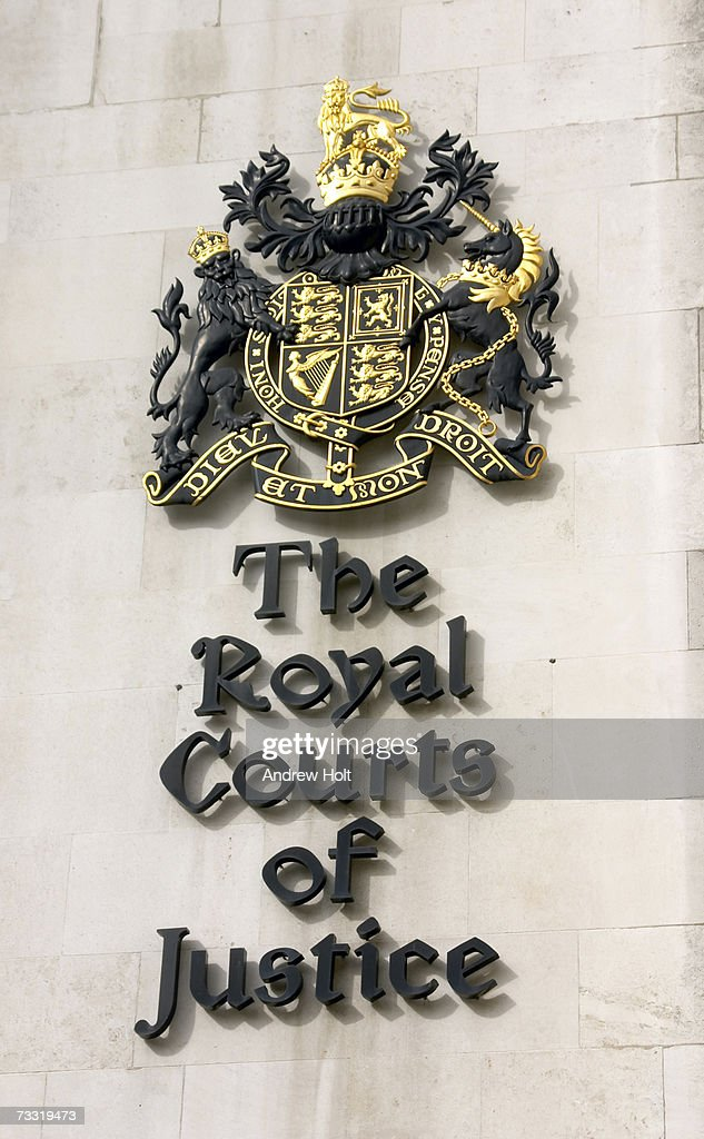 England, London, Royal Courts of Justice logo sign, close-up