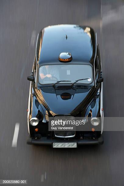 England, London, taxi driving, elevated view, (blurred motion)