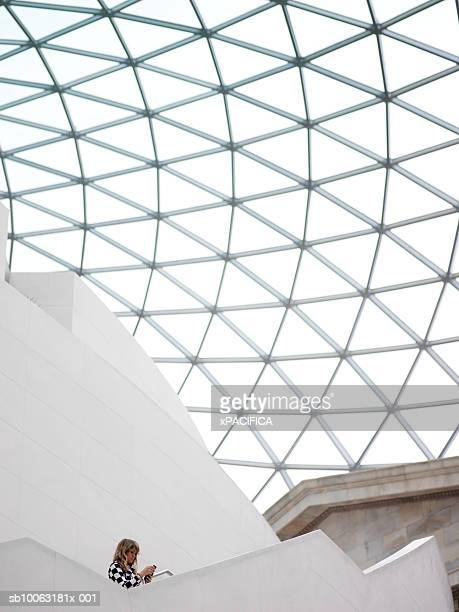 England, London, young woman on stairs of British Museum