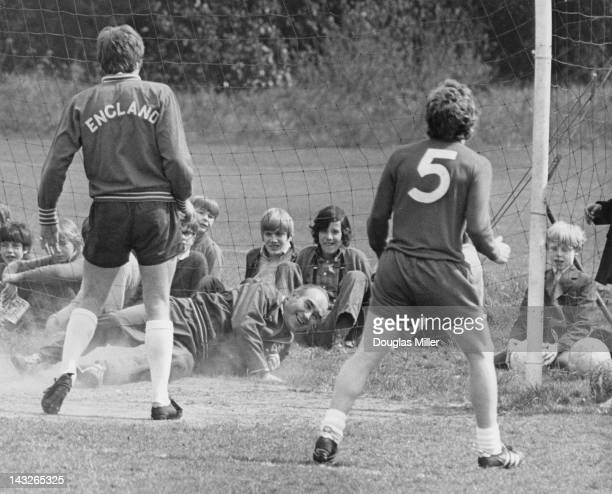 England manager Alf Ramsey acting as goalkeeper during a training session with the national team at Roehampton the day before a European Cup match...