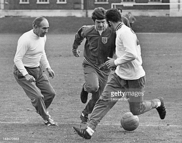 England manager Alf Ramsey with Brian Kidd and Paul Reaney during a training session at Roehampton 24th November 1970 The England team is preparing...