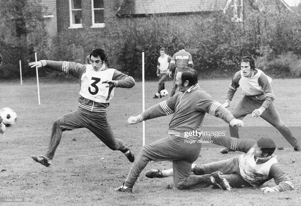 England manager Don Revie (1927 - 1989, centre) during a training session with the national team at Whetstone, north London, 12th November 1976. Also in action are Ray Clemence (right), Dave Clement (1948 - 1982, left) and Mike Doyle (1946 - 2011, on ground).