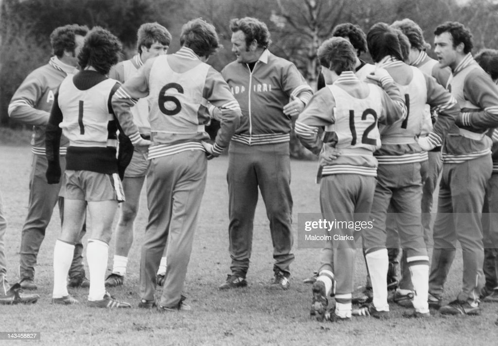England manager Don Revie (1927 - 1989, centre), with his team at a training session to prepare for a World Cup qualifying match against Luxembourg ar Wembley, 28th March 1977.