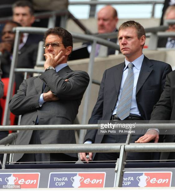 England manager Fabio Capello and coach Stuart Pearce in the stands