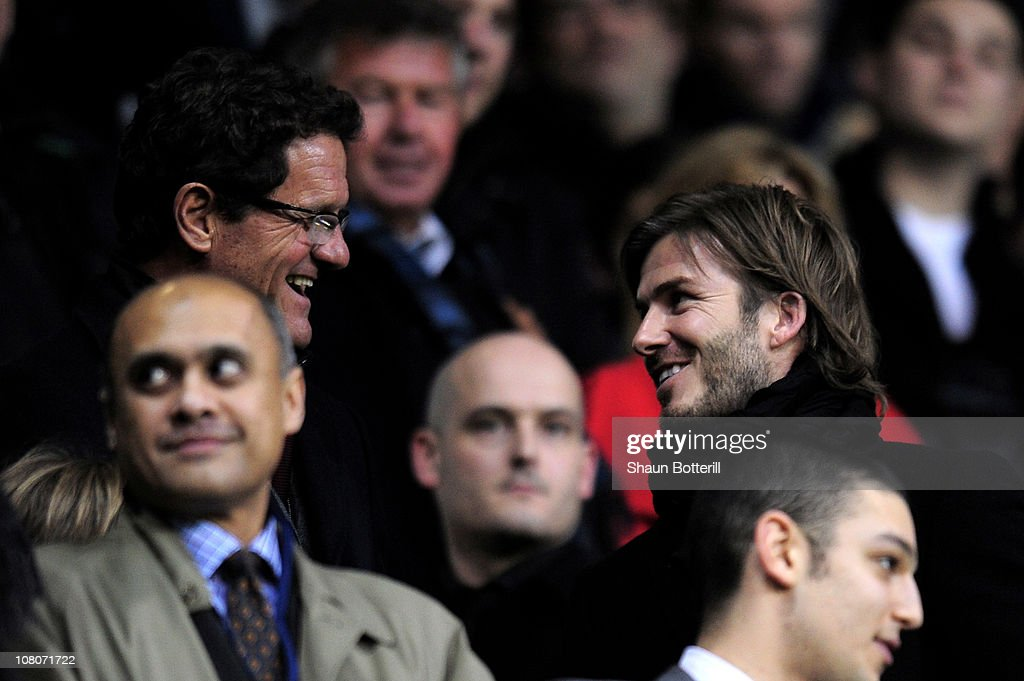 England manager <a gi-track='captionPersonalityLinkClicked' href=/galleries/search?phrase=Fabio+Capello&family=editorial&specificpeople=241290 ng-click='$event.stopPropagation()'>Fabio Capello</a> and <a gi-track='captionPersonalityLinkClicked' href=/galleries/search?phrase=David+Beckham&family=editorial&specificpeople=158480 ng-click='$event.stopPropagation()'>David Beckham</a> chat prior to kickoff during the Barclays Premier League match between Tottenham Hotspur and Manchester United at White Hart Lane on January 16, 2011 in London, England.