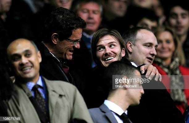 England manager Fabio Capello and David Beckham chat prior to kickoff during the Barclays Premier League match between Tottenham Hotspur and...