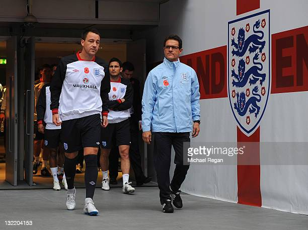England manager Fabio Capello and John Terry lead out the team before their training session at Wembley Stadium on November 11 2011 in London England