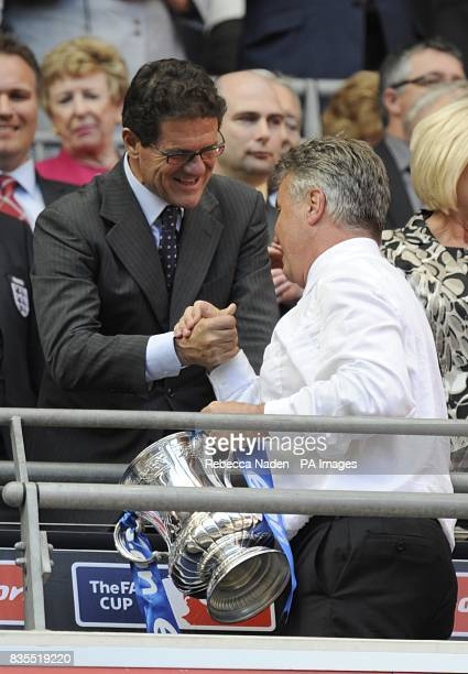 England manager Fabio Capello congratulates Chelsea manager Guus Hiddink with the FA Cup Trophy