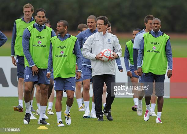 England manager Fabio Capello looks on with Peter Crouch Joleon Lescott Ashley Young Kyle Walker and Ashley Young during the England training session...