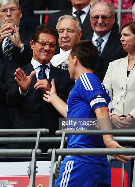 England manager Fabio Capello shakes hands with John Terry of Chelsea after the FA Community Shield match between Chelsea and Manchester United at...