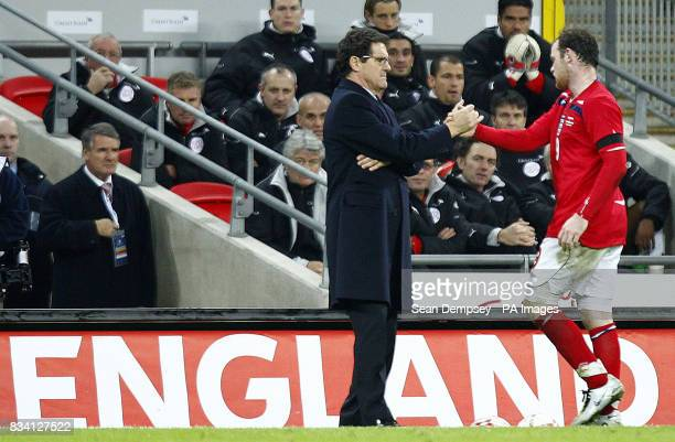 England manager Fabio Capello shakes hands with Wayne Rooney after his substitution during the International Friendly match at Wembley Stadium London