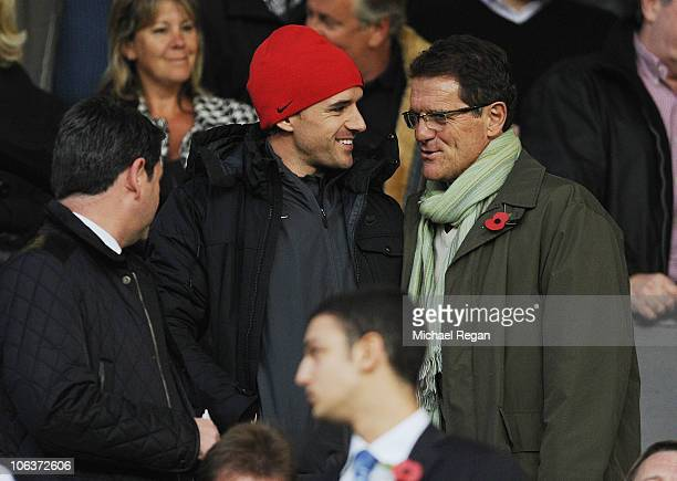 England manager Fabio Capello talks to Owen Hargreaves before the Barclays Premier League match between Manchester United and Tottenham Hotspur at...