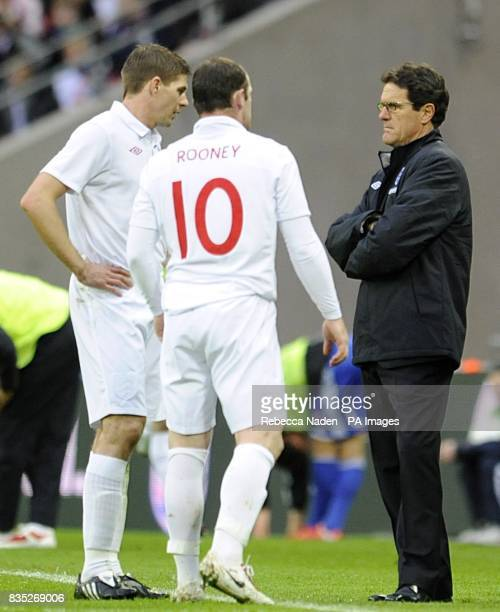 England manager Fabio Capello talks to Steven Gerrard and Wayne Rooney on the touchline