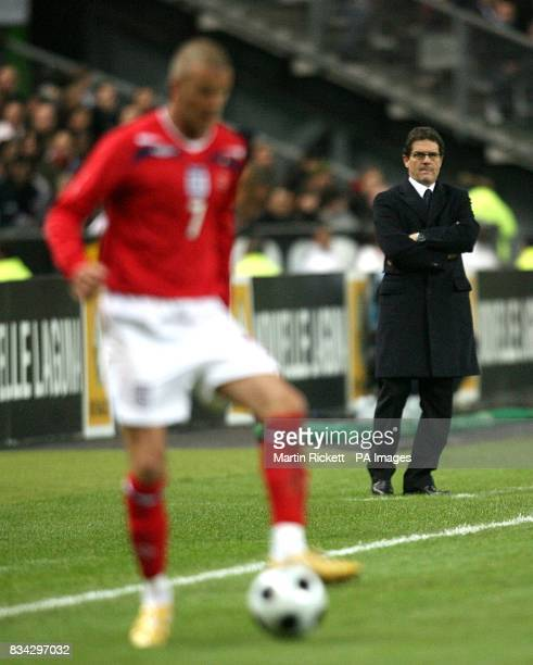 England manager Fabio Capello watches England's David Beckham as he makes his 100th cap