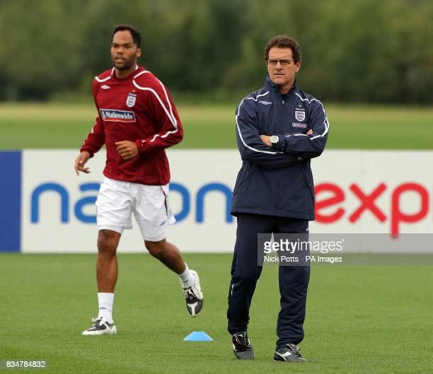 England Manager Fabio Capello watches his players during a training session at London Colney in Hertfordshire