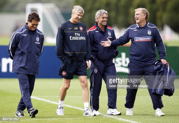 England manager Fabio Capello with Arsene Wenger Franco Baldini and Tevor Brooking during the training session at London Colney London