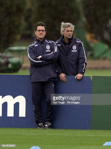 England manager Fabio Capello with Franco Baldini during a training session at London Colney Hertfordshire