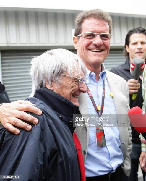 England manager Fabio Capello with President and CEO of Formula One Bernie Ecclestone in the paddock during the practice session at Silverstone...