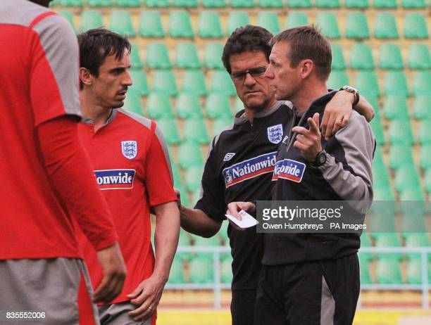 England manager Fabio Capello with Stuart Pearce and Gary Neville during a training session at Central Stadium Almaty Kazakhstan