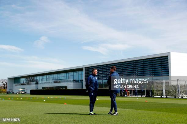 England manager Gareth Southgate and assistant Steve Holland converse ahead of a training session at Tottenham Hotspur's training complex in Enfield...